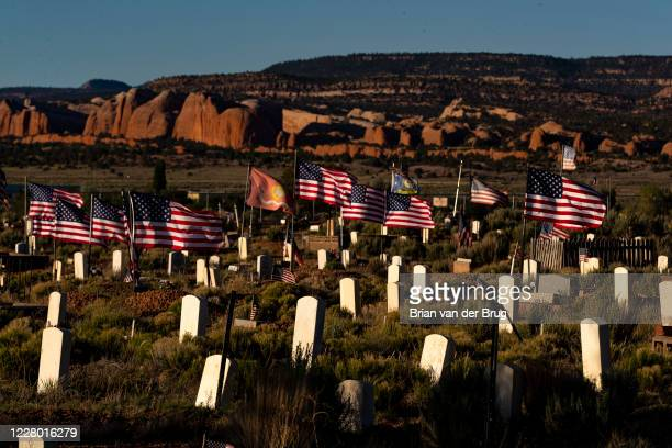 American flags wave in the wind at the Fort Defiance Veterans Memorial Cemetery during the 57-hour stay-at-home order on the Navajo Reservation on...