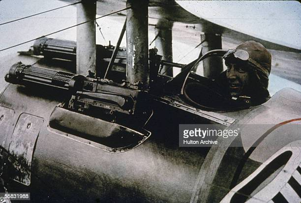 American flying ace Eddie Rickenbacker sits in his Nieuport 28 fighter plane and smiles at the camera 1910s Dubbed America's 'Ace of Aces'...