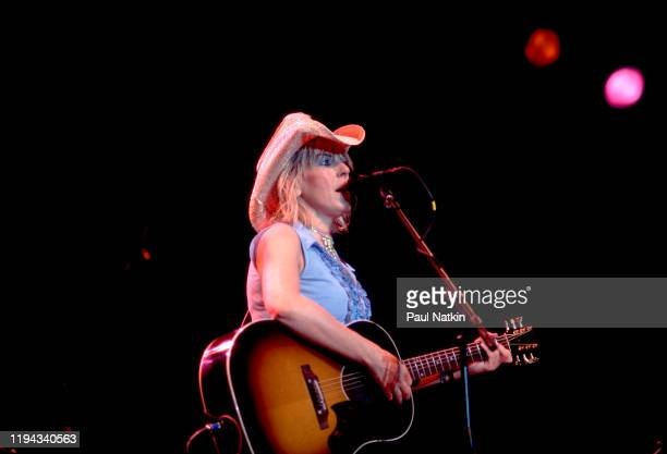 American Folk and Country musician Lucinda Williams plays guitar as she performs onstage at the Navy Pier's Skyline Stage Chicago Illinois June 18...