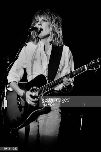 American Folk and Country musician Lucinda Williams plays guitar as she performs onstage at the Park West Chicago Illinois September 20 1992