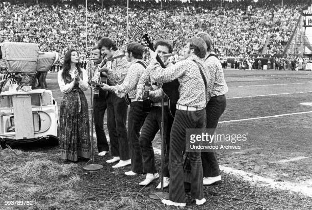 American folk and pop group the New Christy Minstrels perform on the field during the halftime show at Super Bowl IV in Tulane Stadium, New Orleans,...