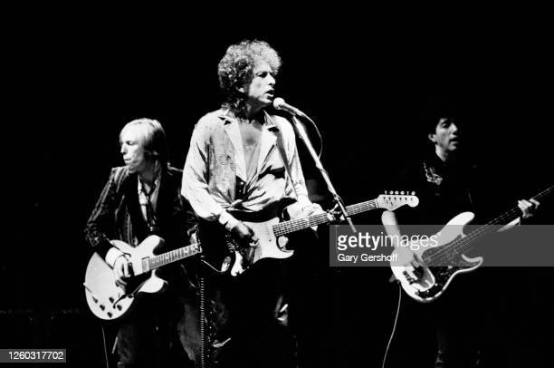 American Folk and Pop musician Bob Dylan plays guitar as he performs onstage during the 'True Confessions Tour' at Madison Square Garden, New York,...