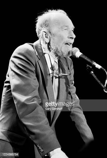 American Folk musician and activist Pete Seeger speaks onstage during the Third Annual Rock and Roll Hall of Fame Awards ceremony at the Waldorf...