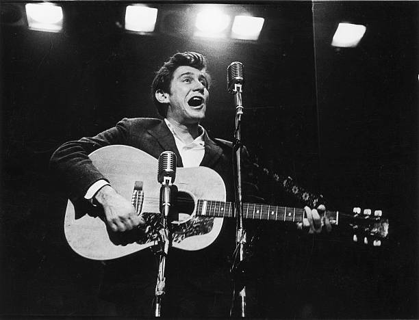 Phil Ochs Performs On Stage