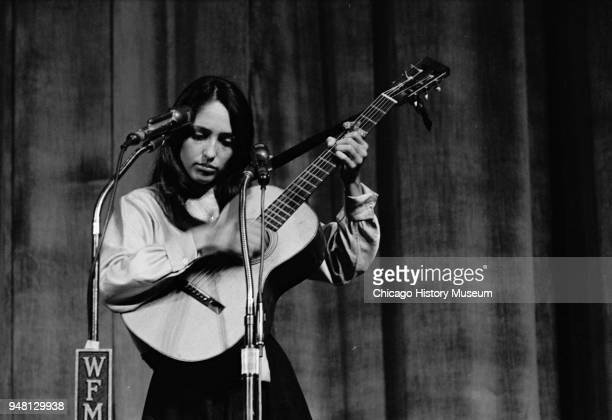 American Folk musician Joan Baez plays guitar as she performs onstage Chicago Illinois circa 1962