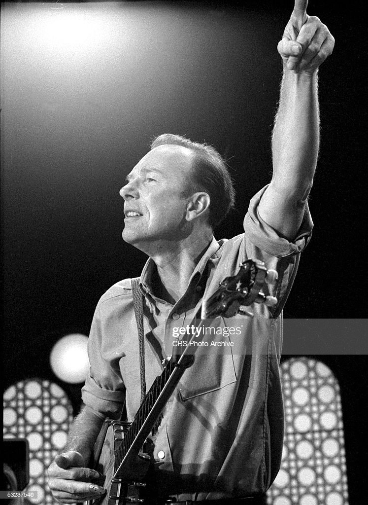 American folk musician Pete Seeger points upward as he performs a song as the musicial guest on an episode of the television variety show 'The Smothers Brothers Comedy Hour,' September 10, 1967. The show had been recorded nine days earlier, on September 1.