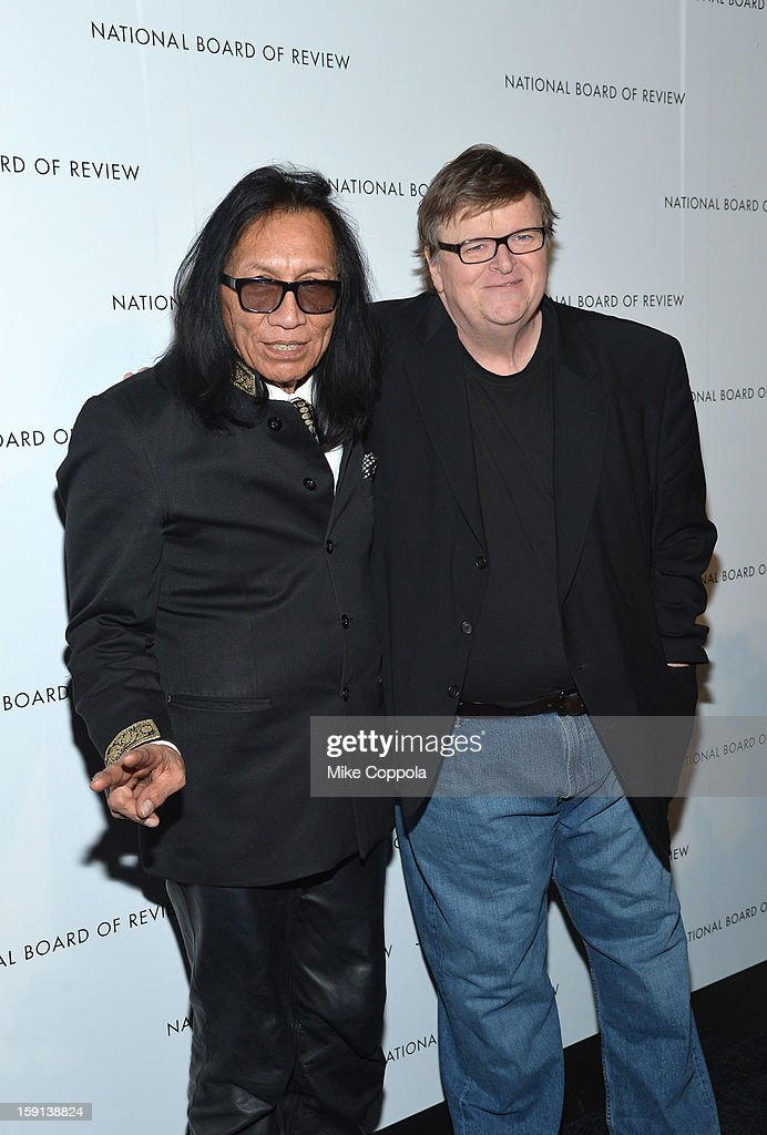 American folk musician Rodriguez and Director Michael Moore attend the 2013 National Board Of Review Awards at Cipriani 42nd Street on January 8, 2013 in New York City.