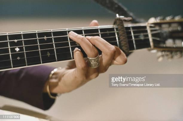 American folk singer and songwriter Joan Baez on the guitar 1965