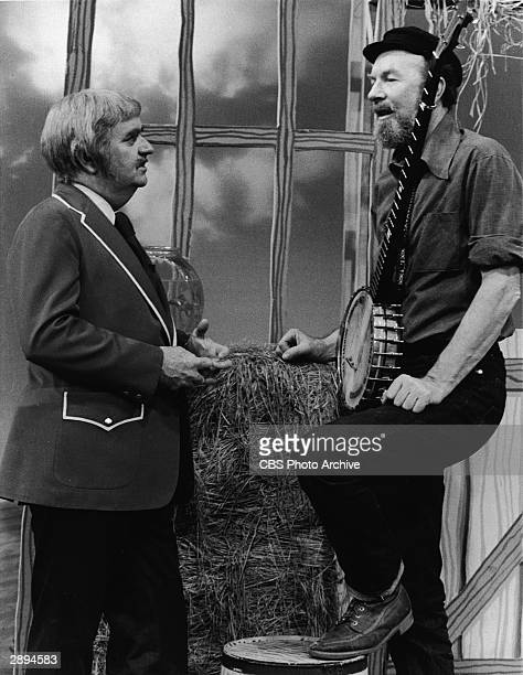 American folk singer and songwriter Pete Seeger makes an appearance on the television series 'Captain Kangaroo' with host Robert Keeshan December 14...
