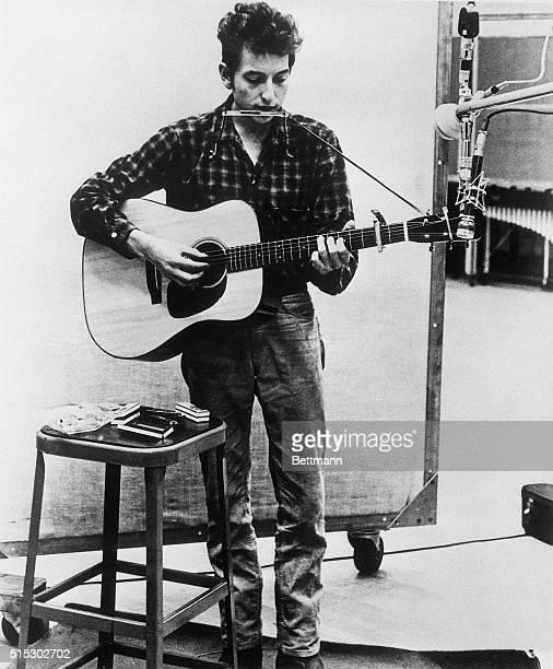 American folk singer Bob Dylan in a recording studio circa 1962
