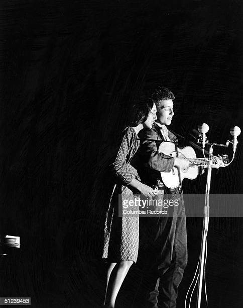 1963 American folk singers Bob Dylan and Joan Baez performing together onstage