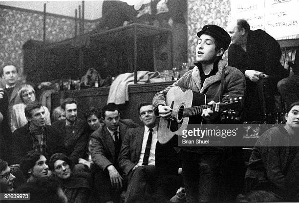 Photo of Bob DYLAN performing live onstage at the Singers Club Christmas party on his first visit to Britain