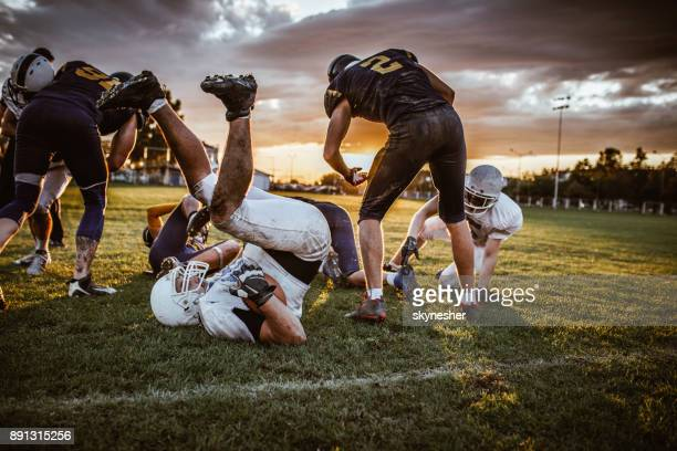 American football action at sunset!