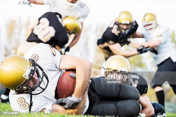 american football action. - touchdown stock pictures, royalty-free photos & images