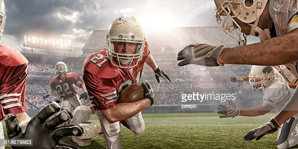 american football action - sports team event stock photos and pictures
