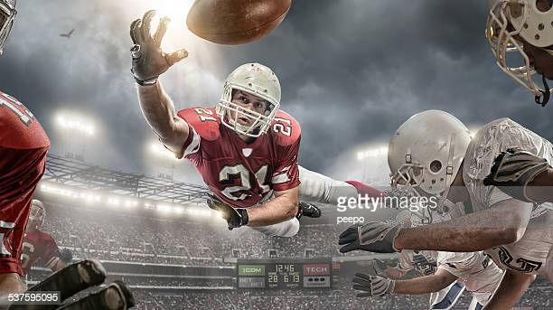 american football action - catching stock pictures, royalty-free photos & images