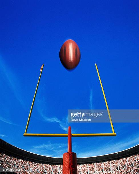 american football, ball flying over goal (digital composite) - アメリカンフットボールのフィールドゴール ストックフォトと画像