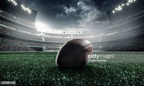 american football ball - football stockfoto's en -beelden