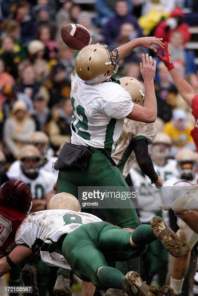 american football - blocked pass - quarterback stock pictures, royalty-free photos & images
