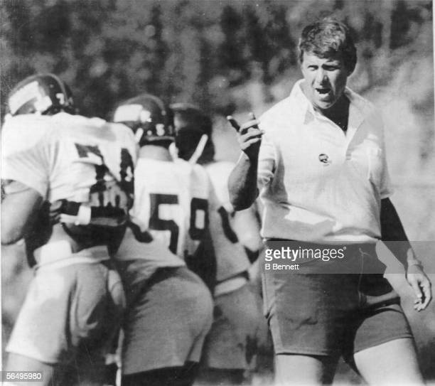 American football coach Bill Parcells head coach of the New York Giants shouts instructions to his players at training camp Pleasantville New York...