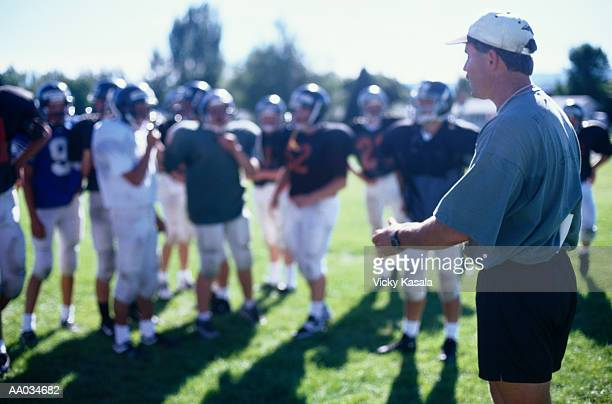 American Football Coach Directing Players