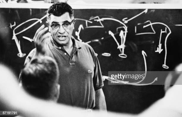 American football coach Vince Lombardi of the Green Bay Packers gestures as he makes a point during a strategy session 1963