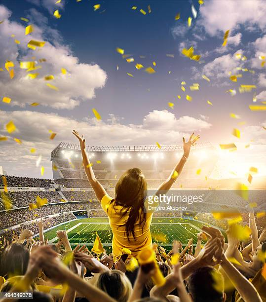 american football fans at stadium - football body paint stock photos and pictures