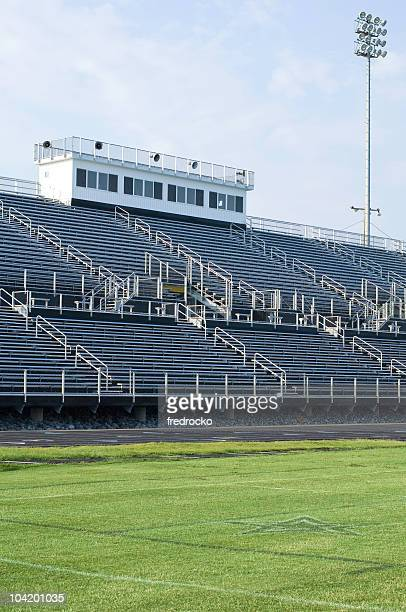 american football field at football game - empty bleachers stock photos and pictures