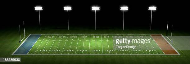 american football field at night - football field stock pictures, royalty-free photos & images