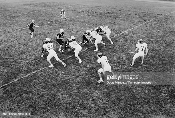 american football game, elevated view (b&w) - safety american football player stock pictures, royalty-free photos & images