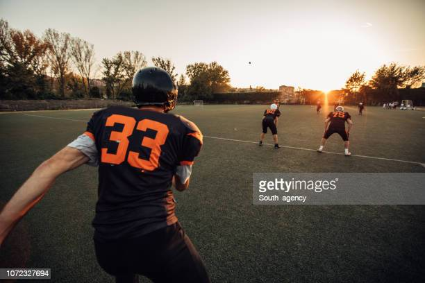 american football game outdoors - guard american football player stock pictures, royalty-free photos & images