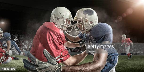american football game - face off sports play stock photos and pictures