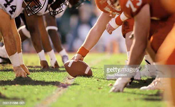 american football game, players at line of scrimmage, close-up - amerikanischer football stock-fotos und bilder