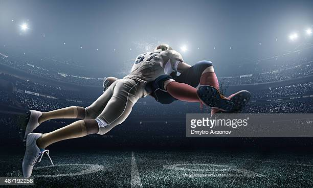 american football in action - tackle american football player stock pictures, royalty-free photos & images