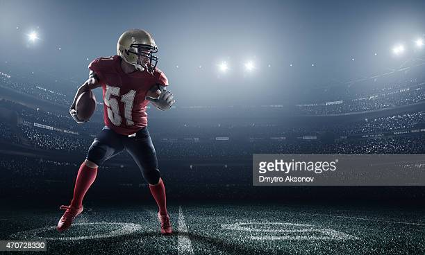 american football in action - football player stock pictures, royalty-free photos & images
