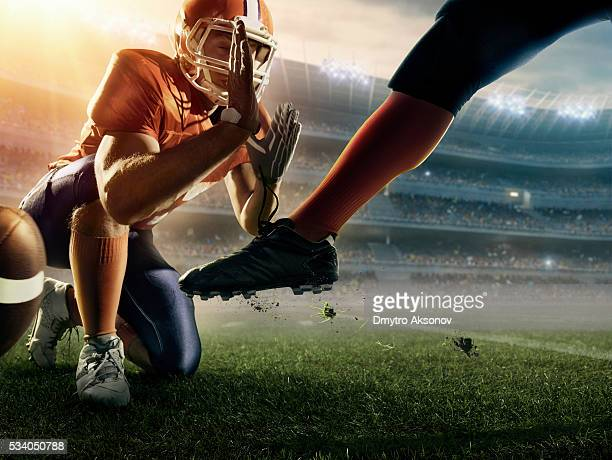 american football kick off - punt kick stock pictures, royalty-free photos & images