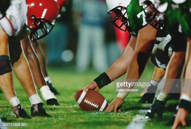 american football line of scrimmage, ground view (digital enhancement) - face off sports play stock photos and pictures