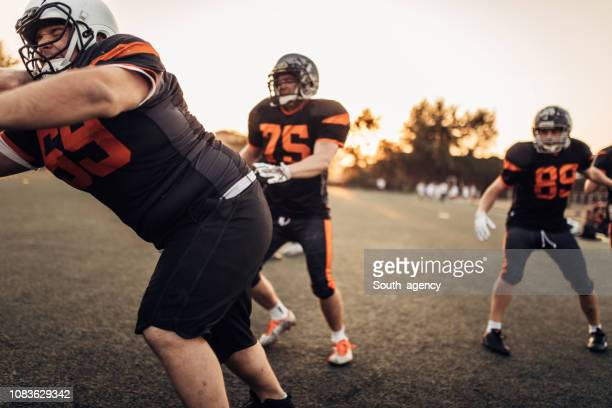 american football match - guard american football player stock photos and pictures
