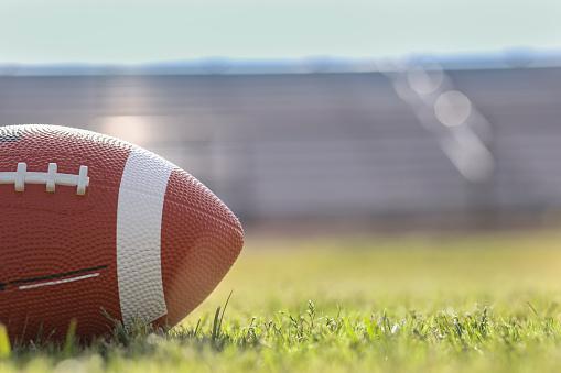 American football on stadium field at school campus. 1166450847