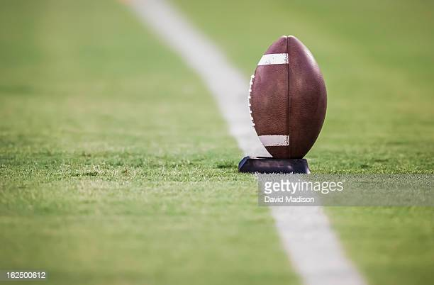 american football on tee. - kick off stock pictures, royalty-free photos & images