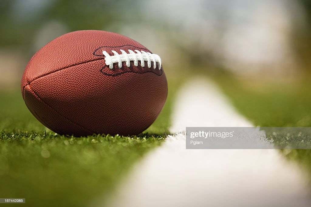 American football on the turf : Stock Photo