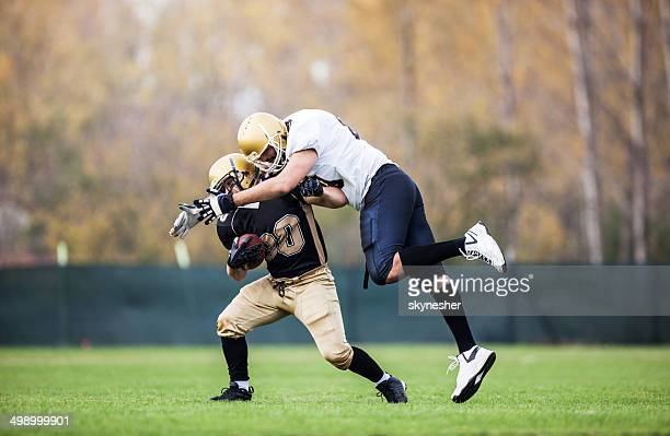 american football. - tackling stock pictures, royalty-free photos & images