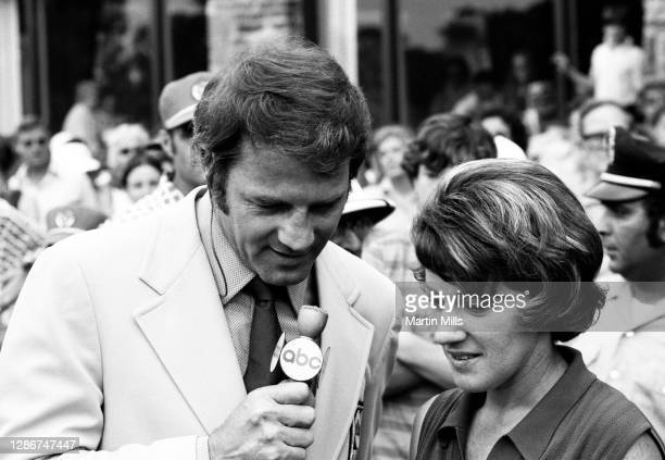 American football player, actor, and ABC television sports commentator Frank Gifford interviews Susie Berning of the United States after she won the...