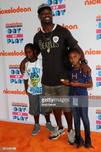 """American football player Bart Scott walks the """"orange"""" carpet for the 10th Annual Worldwide Day of Play at Prospect Park on September 21 2013 in New..."""