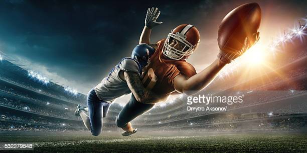 american football player being tackled - quarterback stock pictures, royalty-free photos & images