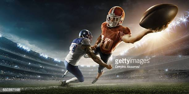 american football player being tackled - quarterback stock photos and pictures