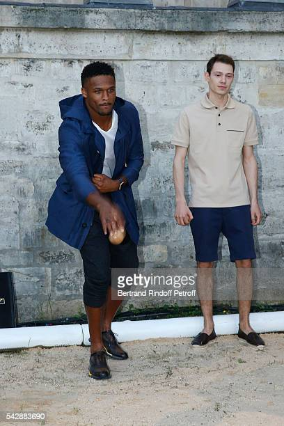 American football player Brice Butler and Model attend the Berluti Menswear Spring/Summer 2017 show as part of Paris Fashion Week on June 24, 2016 in...