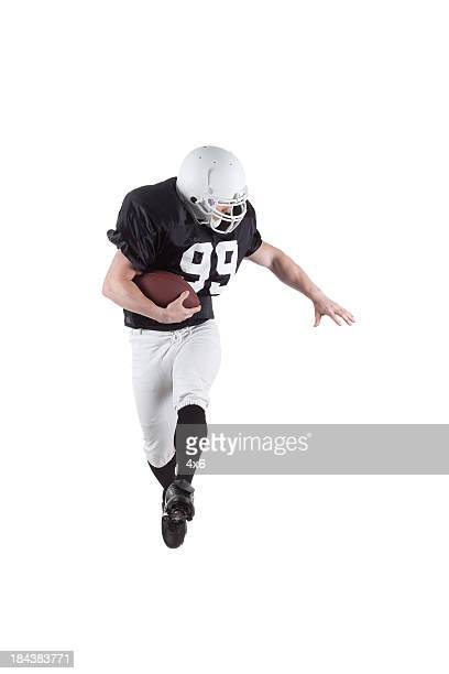 american football player carrying a rugby - american football strip stock pictures, royalty-free photos & images