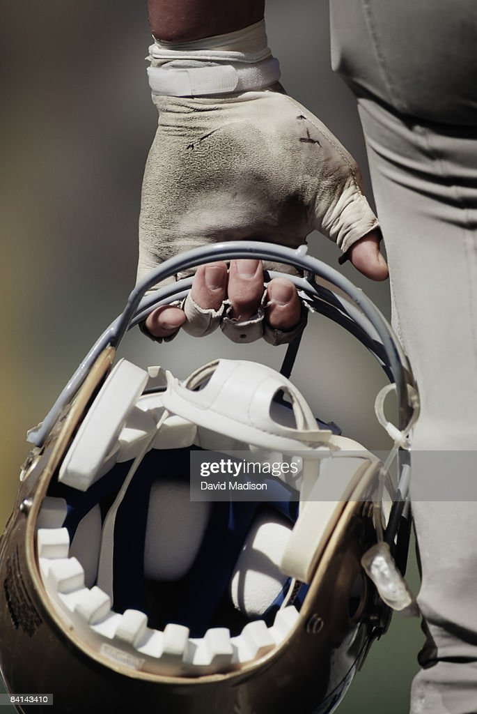 American football player carrying helmet : Stock Photo