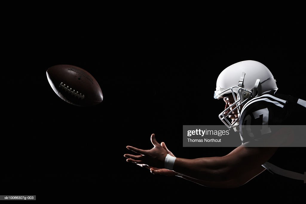 American Football Player Catching Ball Side View High Res
